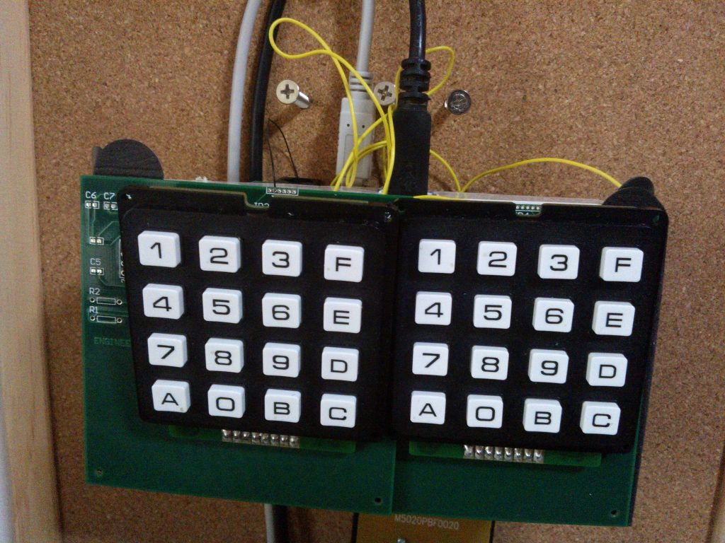 EngineeeringComputerWorks.com Dual Keypad and additional keypads is able to be added to the Computer Control System by linking and networking the Microchip PIC 16C63A by connecting the serial connections together. The video shows the game from Pacific Warriors flying the American Plane by a Dual Keypad Computer Controller System. The Dual Keypad Computer Control System is pictured in the video as a prototype and as a complete packaging solution in the pictures. For enquiries, please email : cjhoong@msn.com ; chan_junt_hoong@ieee.org ; chanjunthoong@theiet.org .